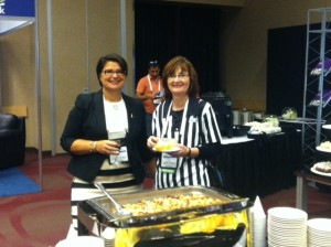 "RIMS Executive Director Mary Roth and one of the conference's ""referees."""